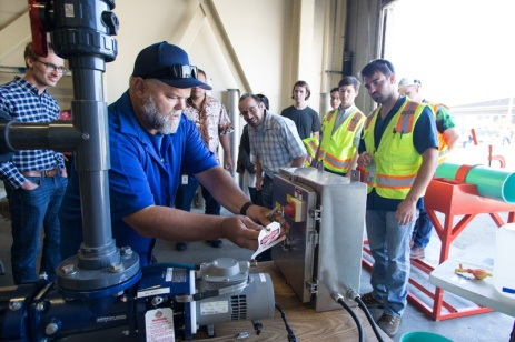 Assistant Offsite Supervisor gives demonstration of the lockout/tagout sequence before before six teams compete in the Operations Challenge .