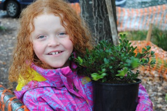 A happy planter at West Woodland Elementary