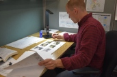 Engineer Sammy Wood studies technical drawings