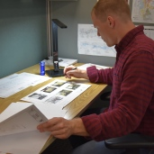 Engineer Sammy Wood studies technical drawings