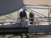 Mechanics replace tank ducts.