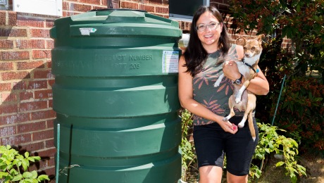 A homeowner with their cistern