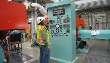 Wastewater operator checks equipment