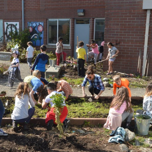 kids at a community garden event (pre-COVID-19)