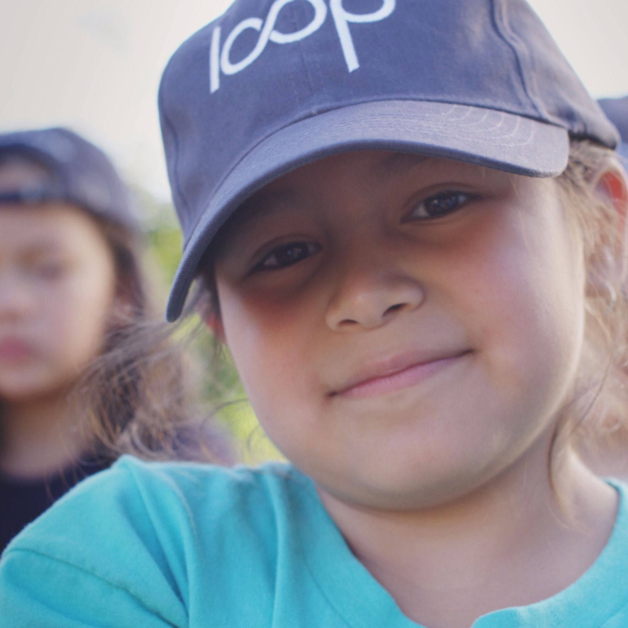 child smiling wearing Loop hat