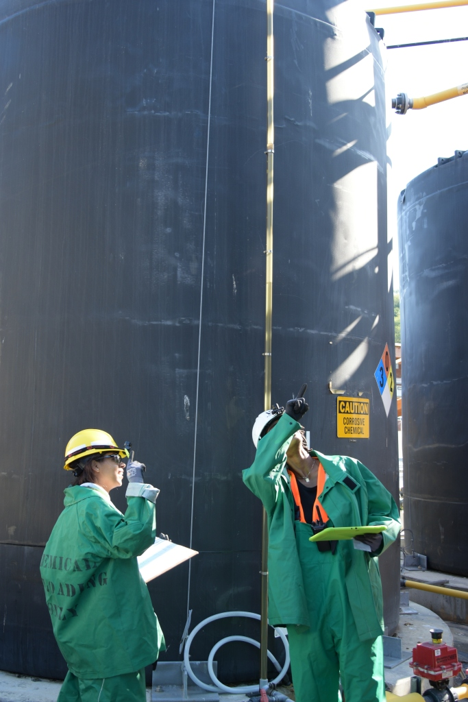 Engineers inspect the sodium hypochlorite tanks at West Point Treatment Plant